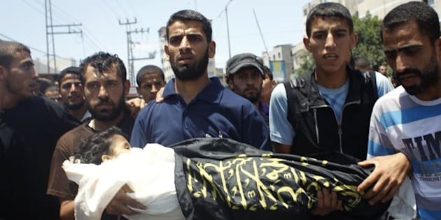 Palestinian mourners carry the body of four-year-old girl Sarah Sheik al-Eid after she was killed along with her father and uncle in a Israeli military strike the previous day, during their funeral in Rafah in the southern Gaza Strip on July 15, 2014 . Israel carried out at least four air strikes against Gaza on Tuesday afternoon, resuming raids after a truce that failed to get off the ground, AFP correspondents and eyewitnesses said.  AFP PHOTO/SAID KHATIB        (Photo credit should read SAID KHATIB/AFP/Getty Images)