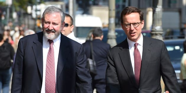 Attornies Carmine Boccuzzi (R) and Jonathan Blackman arrive at the US Federal Courthouse July 22, 2014 in New York. US judge Thomas Griesa on Tuesday ordered Argentina and New York-based hedge funds to urgently reach a deal to avoid Buenos Aires defaulting over more than $1.3 billion in unpaid debts. Presiding over a hearing in his Manhattan courtroom, Griesa refused to grant a request from lawyers for the South American country asking that a US Supreme Court ruling be suspended. The lawyer appointed by Griesa to mediate an agreement between the two sides, Daniel Pollack, has scheduled another meeting on Wednesday to find a solution before Argentina could be forced to default on July 31.