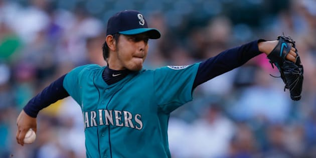SEATTLE, WA - JULY 07:  Starting pitcher Hisashi Iwakuma #18 of the Seattle Mariners pitches in the first inning against the Minnesota Twins at Safeco Field on July 7, 2014 in Seattle, Washington.  (Photo by Otto Greule Jr/Getty Images)