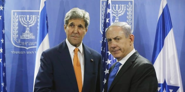 US Secretary of State John Kerry (L) shakes hands with Israeli Prime Minister Benjamin Netanyahu in Tel Aviv on July 23, 2014. Kerry is meeting with United Nations Secretary-General Ban Ki-moon, Netanyahu, and Palestinian president Mahmud Abbas as efforts for a cease-fire between Hamas and Israel continues. AFP PHOTO / POOL        (Photo credit should read POOL/AFP/Getty Images)