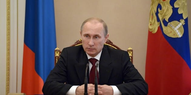 Russia's President Vladimir Putin chairs a Security Council meeting in the Kremlin in Moscow, on July 1, 2014. Ukrainian forces pressed on with their assault on pro-Russian insurgents after Kiev's Western-backed leader brushed off European efforts to save a tenuous truce, prompting Russia to raise alarm over the 'swiftly deteriorating' situation. Putin said yesterday Ukrainian President Petro Poroshenko was assuming responsibility for future casualties and gathered his top security aides to discuss the 'swiftly deteriorating' situation in his western neighbour. AFP PHOTO/ RIA-NOVOSTI/ POOL /ALEXEI NIKOLSKY        (Photo credit should read ALEXEI NIKOLSKY/AFP/Getty Images)