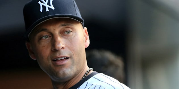 NEW YORK, NY - JULY 22:  Derek Jeter #2 of the New York Yankees looks on from the dugout before the game against the Texas Rangers on July 22, 2014 at Yankee Stadium in the Bronx borough of New York City.  (Photo by Elsa/Getty Images)