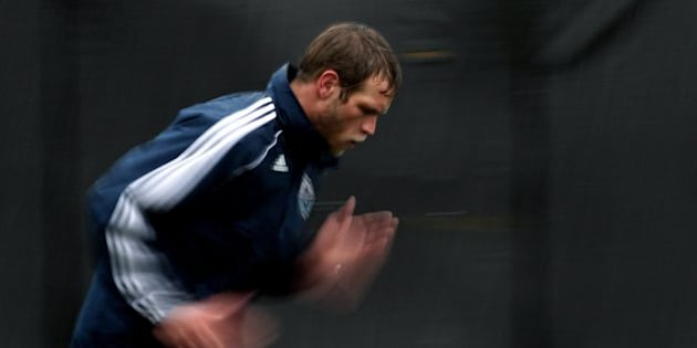 Vancouver Whitecaps' Jay DeMerit goes through a drill during the opening day of the MLS soccer team's training camp in Vancouver, B.C., on Monday January 24, 2011. The Whitecaps are one of two expansion teams joining MLS for the 2011 season. (AP Photo/The Canadian Press, Darryl Dyck)