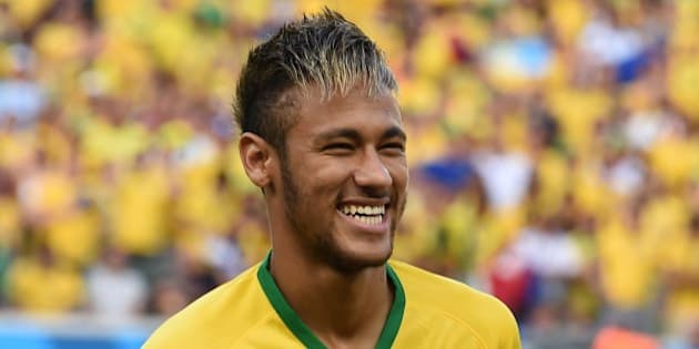 Brazil's forward Neymar smiles before the quarter-final football match between Brazil and Colombia at the Castelao Stadium in Fortaleza during the 2014 FIFA World Cup on July 4, 2014. AFP PHOTO / VANDERLEI ALMEIDA        (Photo credit should read VANDERLEI ALMEIDA/AFP/Getty Images)