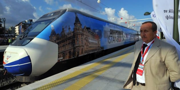 A man stands by the first Turkish high-speed train at Pendik railway station, in Istanbul, during the high-speed train opening cerenomy on July 25, 2014. Turkish Prime Minister Recep Tayyip Erdogan inaugurated the first high-speed train link between Ankara and Istanbul on July 25, 2014, his latest ambitious grand engineering project, but arrived late after a technical problem on the maiden trip. AFP PHOTO / OZAN KOSE        (Photo credit should read OZAN KOSE/AFP/Getty Images)