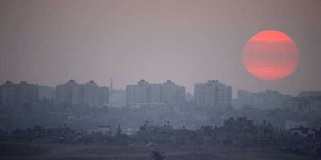 A picture taken from the Israeli border with the Gaza Strip shows the sun setting over the Palestinian coastl enclave on July 29, 2014.. The Israeli offensive, which began on July 8 to end Hamas rocket attacks on the Jewish state, has killed more than 1,100 Palestinians, mostly civilians according to the United Nations, while 56 lives have been lost on the Israeli side, all but three of them soldiers . AFP PHOTO / JACK GUEZ        (Photo credit should read JACK GUEZ/AFP/Getty Images)