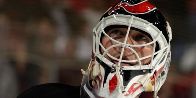 NEWARK, NJ - APRIL 11:  Martin Brodeur #30 of the New Jersey Devils takes a break during the third period against the New York Islanders at the Prudential Center on April 11, 2014 in Newark, New Jersey.  The Islanders defeated the Devils 3-2 in the shootout.  (Photo by Bruce Bennett/Getty Images)