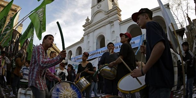 Demonstrators bang their bass drums during a demonstration at Plaza de Mayo square in Buenos Aires on July 30, 2014. Argentina was locked in 11th-hour talks on Wednesday to seek a deal with 'holdout' creditors and stave off a crippling new default -- the second in 13 years -- at day's end. Buenos Aires had until midnight to resolve its dispute with two US hedge funds whose refusal to accept a write-down on debt it defaulted on in 2001 has pushed Latin America's third-largest economy to the brink of a new crisis.     AFP PHOTO / JUAN MABROMATA        (Photo credit should read JUAN MABROMATA/AFP/Getty Images)