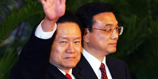 BEIJING - OCTOBER 22:  Zhou Yongkang, one of the new nine-seat Politburo Standing Committee, greets the media at the Great Hall of the People on October 22, 2007 in Beijing. China's ruling Communist Party today revealed the new nine-seat Politburo Standing Committee after its 17th congress.  (Photo by Feng Li/Getty Images)
