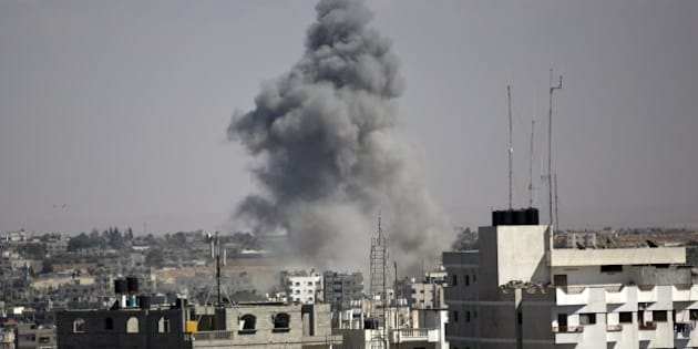 Smoke rises following an Israeli strike in Rafah, in the southern Gaza Strip on August 3, 2014. At least 10 people were killed in a fresh strike on a UN school in southern Gaza which was sheltering Palestinians displaced by an Israeli military offensive, medics said. AFP PHOTO / MAHMUD HAMS        (Photo credit should read MAHMUD HAMS/AFP/Getty Images)