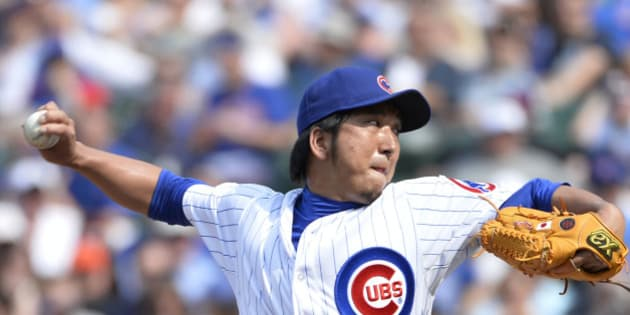 CHICAGO, IL- MAY 19: Relief pitcher Kyuji Fujikawa #11 of the Chicago Cubs delivers during the eighth inning against the New York Mets on May 19, 2013 at Wrigley Field in Chicago, Illinois. (Photo by Brian Kersey/Getty Images)
