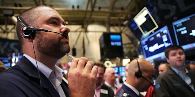 NEW YORK, NY - AUGUST 01:  Traders work on the floor of the New York Stock Exchange (NYSE) on August 1, 2014 in New York City. Following a huge sell off yesterday, the Dow opened down over 20 points in morning trading.  (Photo by Spencer Platt/Getty Images)