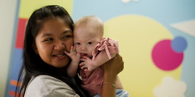 Thai surrogate mother Pattaramon Chanbua (L) holds her baby Gammy, born with Down Syndrome, at the Samitivej hospital, Sriracha district in Chonburi province on August 4, 2014. The surrogate mother of a baby reportedly abandoned by his Australian parents in Thailand because he has Down Syndrome was a 'saint' and 'absolute hero', Australian Immigration Minister Scott Morrison said. AFP PHOTO / Nicolas ASFOURI        (Photo credit should read NICOLAS ASFOURI/AFP/Getty Images)