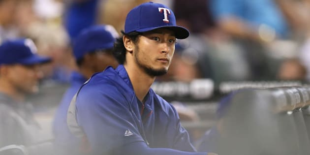 CHICAGO, IL - AUGUST 05:  Yu Darvish #11 of the Texas Rangers watches a game against the Chicago White Sox from the dugout at U.S. Cellular Field on August 5, 2014 in Chicago, Illinois.  (Photo by Jonathan Daniel/Getty Images)