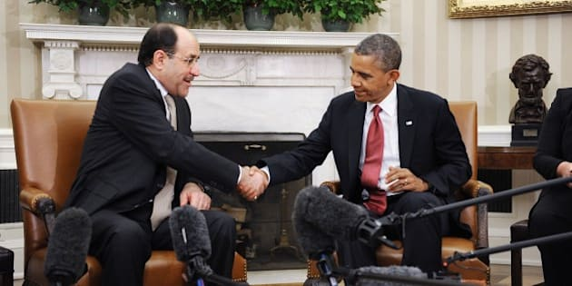 WASHINGTON, DC - NOVEMBER 01: Iraqi Prime Minister Nouri Al-Maliki (L) shakes hands with U.S. President Barack Obama in the Oval Office at the White House November 1, 2013 in Washington, DC.  Al-Maliki was expected to request additional U.S. assistance in battling a rising wave of violence in Iraq.  (Photo by Olivier Douliery-Pool/Getty Images)