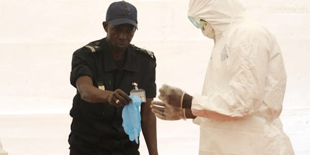A Senegalese hygienist demonstrates how to protect oneself against the Ebola virus on April 8, 2014 at Dakar airport, during a visit of the Senegalese health minister to check the safety measures put in place to fight against the virus' spread in western Africa. West Africa's Ebola outbreak is among the 'most challenging' ever to strike since the disease emerged four decades ago, the World Health Organisation (WHO) said on April 8, as the suspected death toll from the virus hit 111.   AFP PHOTO / SEYLLOU        (Photo credit should read SEYLLOU/AFP/Getty Images)
