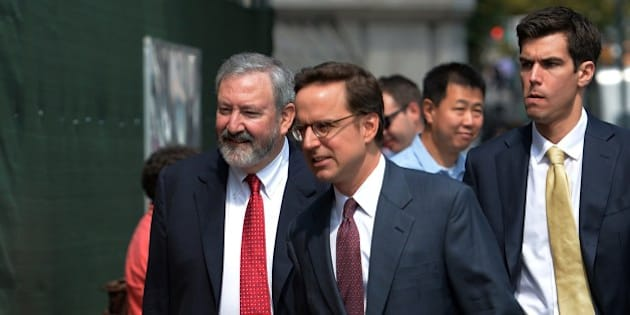 Attorneys Carmine Boccuzzi (C) and Jonathan Blackman (L) arrive at the US Federal Courthouse August 1, 2014 in New York where talks continue into the Argentinian debt.  Argentina said there was little hope of resolving its damaging debt dispute at a US court hearing Friday, accusing the judge of bias as repercussions from its partial default continued to mount. AFP PHOTO/Stan HONDA        (Photo credit should read STAN HONDA/AFP/Getty Images)
