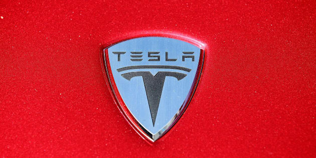 PALO ALTO, CA - MAY 20:  The Tesla Motors logo is seen on the hood of a car at Tesla Motors headquarters May 20, 2010 in Palo Alto, California. Electric car maker Tesla Motors is set to annoucne a  partnership with Japanese automaker Toyota to make electric cars in California.  (Photo by Justin Sullivan/Getty Images)