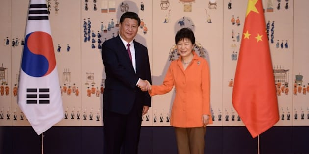 China's President Xi Jinping (L) shakes hands with his South Korean counterpart Park Geun-Hye (R) prior to a summit meeting at the Blue House in Seoul on July 3, 2014. China's president arrived in Seoul for a state visit seen as a snub to Beijing's traditional ally North Korea, whose nuclear weapons ambitions will dominate talks with South Korean leader Park Geun-Hye. AFP PHOTO / Ed Jones / POOL        (Photo credit should read ED JONES/AFP/Getty Images)