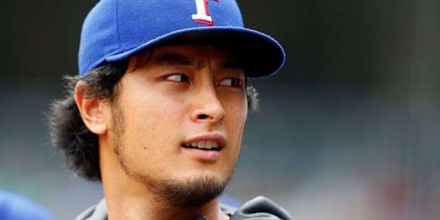 NEW YORK, NY - JULY 24:  Yu Darvish #11 of the Texas Rangers looks on from the dugout in the first inning against the New York Yankees at Yankee Stadium on July 24, 2014 in the Bronx borough of New York City. The Yankees defeated the Rangers 4-2.  (Photo by Jim McIsaac/Getty Images)