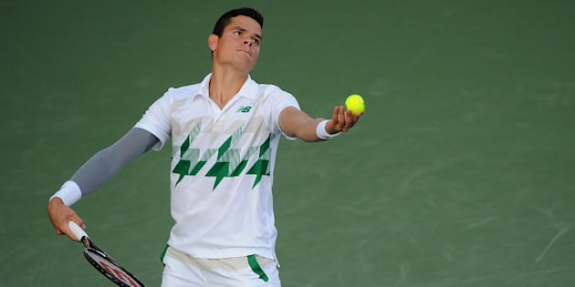 CINCINNATI, OH - AUGUST 13:  Milos Raonic of Canada serves against Robby Ginepri during a match on day 5 of the Western & Southern open at Linder Family Tennis Center on August 13, 2014 in Cincinnati,  Ohio.  (Photo by Jonathan Moore/Getty Images)