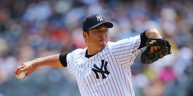 NEW YORK, NY - AUGUST 10:  Hiroki Kuroda #18 of the New York Yankees pitches against the Cleveland Indians during their game at Yankee Stadium on August 10, 2014 in the Bronx borough of New York City.  (Photo by Al Bello/Getty Images)
