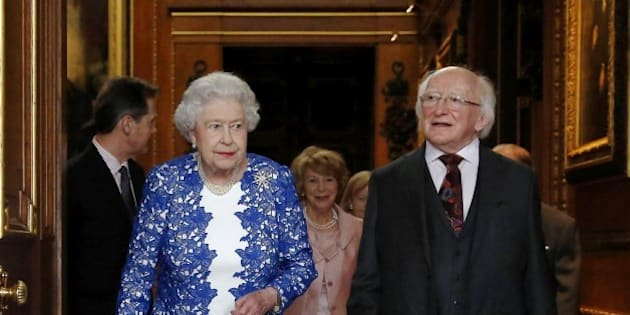 Britain's Queen Elizabeth II and Irish President Michael D Higgins attend a Northern Ireland-themed reception organised as part of the Irish president's state visit to Britain at Windsor Castle in Windsor, west of London, on April 10, 2014.  AFP PHOTO / POOL / LUKE MACGREGOR        (Photo credit should read LUKE MACGREGOR/AFP/Getty Images)