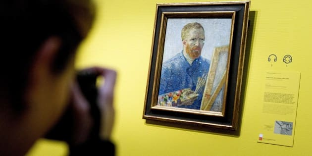 A visitor in the Van Gogh Museum Amsterdam takes a picture of the famous Dutch painter's self portrait with easel dated from 1888 prior to the reopening of the museum, in Amsterdam on May 1, 2013. According to media information the museum was renovated for several months with more than 10,000 square meters of walls painted and about 2,300 square meters of parquet floor laid. Amsterdam's Van Gogh Museum reopened its doors to the public with a stunning new display of some of the Dutch master's greatest works, completing a trio of renovations of the city's most famous museums. AFP PHOTO / ANP -KOEN VAN WEEL = netherlands out 