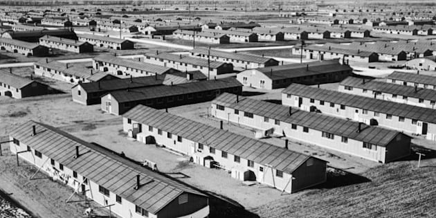 circa 1943:  Aerial view of a Japanese-American relocation center in Amache, Colorado, during World War II.  It is one of 10 barrack-type cities that were constructed as temporary homes for 110,000 people of Japanese descent who were moved away from the Pacific coast. Each family was provided with a space 20 by 25 ft. The barracks were set in blocks and each block was provided with a community bath house and mess hall.  (Photo by Hulton Archive/Getty Images)