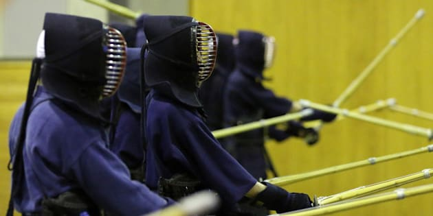 National Defense Academy of Japan (NDA) cadets take part in Kendo, the Japanese martial art of bamboo sword fighting, during extracurricular activities at the NDA campus in Yokosuka, Kanagawa Prefecture, Japan, on Monday, April 21, 2014. Admiration for Japans Self-Defense Forces' role in disaster relief, particularly after the 2011 tsunami, and a deepening territorial dispute with China has fueled national pride and increased interest in the academy even as recruits face an unaccustomed level of danger. Photographer: Yuriko Nakao/Bloomberg via Getty Images