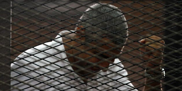 CAIRO, EGYPT - JUNE 23:  An Egyptian court on Monday, June 23, handed out jail terms ranging from three to ten years each to 18 people, including four foreign Al Jazeera journalists convicted of 'fabricating news', eleven defendants including three foreign correspondents including Egyptian-Canadian Mohamed Fadel Fahmy (Seen), were sentenced in absentia to ten years each in jail. Seven others, including Australian Al Jazeera journalist Peter Greste, were sentenced to seven years each.  (Photo by Stringer/Anadolu Agency/Getty Images)