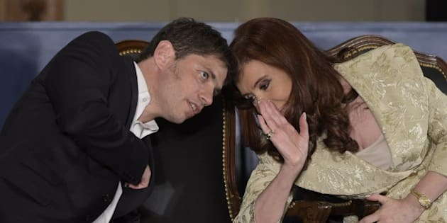 Argentina's President Cristina Fernandez de Kirchner speaks with Argentinian Economy Minister Axel Kicillof during a ceremony for the160th anniversary of Buenos Aires Stock Exchange in Buenos Aires on August 20, 2014. AFP PHOTO / JUAN MABROMATA        (Photo credit should read JUAN MABROMATA/AFP/Getty Images)