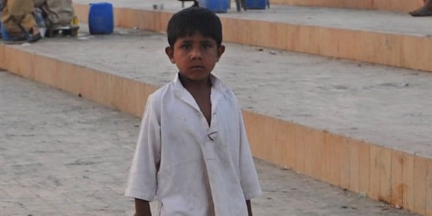 A Pakistani child sells beverages on a beach in Karachi on March 21, 2012 on the eve of the UN World Water Day. More than 2.5 billion people are in need of decent sanitation and nearly one in 10 has yet to gain access to 'improved' drinking water, as defined under the UN's 2015 development goals. AFP PHOTO/Rizwan TABASSUM (Photo credit should read RIZWAN TABASSUM/AFP/Getty Images)