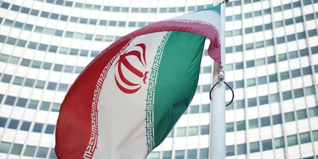 An Iranian flag waves in a wind outside the Vienna International Centre hosting the United Nations (UN) headquarters and the International Atomic Energy Agency (IAEA) as the socalled EU 5+1 talks with Iran take place in Vienna, on July 3, 2014. Negotiators from Iran and six world powers begin a marathon final round of talks towards a potentially historic agreement on Tehran's nuclear programme before a July 20 deadline.