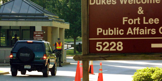 392755 02: Military personnel guard the entrance to Fort Lee Military Base August 2, 2001 in Hopewell, VA. The FBI discounted an anonymous tip to an Internet site alleging that Chandra Levy''s body was buried under a parking lot near the Virginia military base 130 miles south of Washington. (Photo by Alex Wong/Getty Images)