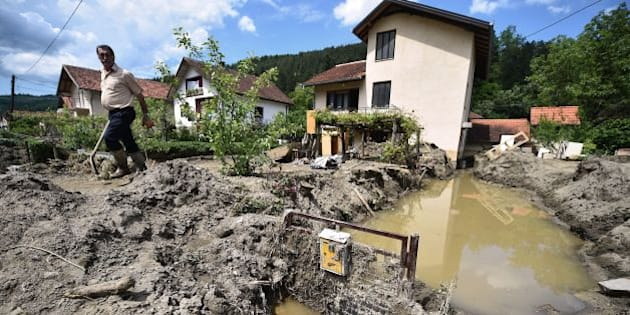 A man walks out from his mud covered front yard in Krupanj, some 130 kilometres south west of Belgrade, on May 20, 2014, after it was hit with floods and landslides, cutting the western Serbian town off for four days. Serbia declared three days of national mourning on May 20 as the death toll from the worst flood to hit the Balkans in living memory rose and health officials warned of a possible epidemic. At least 49 people have been killed already by the worst floods in central Europe for a century and more than 1.6 million people have been hit as the river Sava and its tributaries have burst their banks, inundating tens of thousands of hectares of farmland and destroying houses and buildings.   AFP PHOTO / ANDREJ ISAKOVIC        (Photo credit should read ANDREJ ISAKOVIC/AFP/Getty Images)