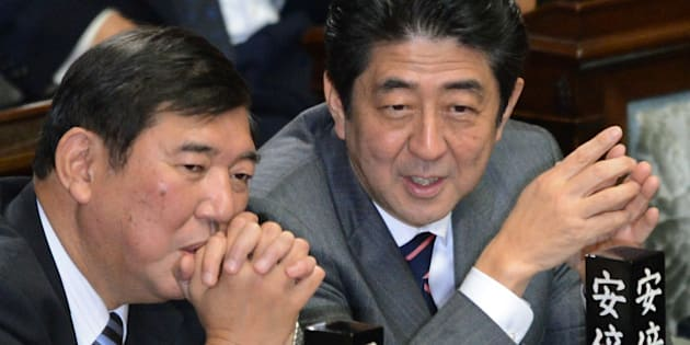 Shinzo Abe (R) chats with Secretary General of the Liberal Democratic Party (LDP) Shigeru Ishiba (L) before voting to elect a new prime minister at the lower house of parliament in Tokyo on December 26, 2012. The powerful lower house named the 58-year-old Abe as the country's new leader following a resounding national election victory for Abe's LDP earlier this month over the booted Democratic Party of Japan (DPJ).    AFP PHOTO/Toru YAMANAKA        (Photo credit should read TORU YAMANAKA/AFP/Getty Images)