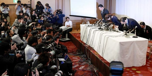Haruko Obokata (R), 30, a female researcher of Japan's Riken Institute bows as she apologises at a press conference in Osaka, western Japan on April 9, 2014, following claims that her ground-breaking stem cell study was fabricated. Obokata is preparing to fight claims that her ground-breaking stem cell study was fabricated, her lawyer said on April 8, as Japan's male-dominated scientific establishment circled its wagons.  AFP PHOTO / JIJI PRESS    JAPAN OUT        (Photo credit should read JIJI PRESS/AFP/Getty Images)