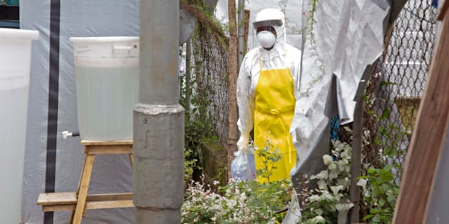 A healthcare worker walks near a Ebola isolation unit wearing protective gear against the virus at Kenema Government Hospital, in Kenema that is in the Eastern Province around 300km, (186 miles), from the capital city of Freetown in Kenema, Sierra Leone, Tuesday, Aug. 12, 2014. The World Health Organization declared Tuesday, it is ethical for unproven drugs and vaccines to be used amid an unprecedented outbreak in West Africa, however it didn't address who should get the limited amount of drugs available and can not predict the result of using untested drugs. (AP Photo/ Michael Duff)