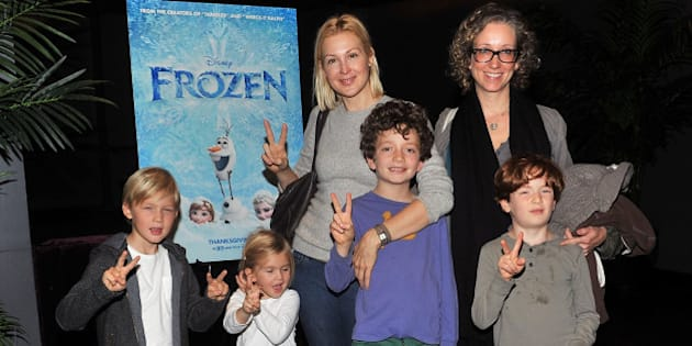 NEW YORK, NY - NOVEMBER 02:  Actress Kelly Rutherford with son Herms Gustaf Daniel (L), daughter Helena Grace Rutherford (2nd L) and guests attend the Disney & The Cinema Society screening of 'Frozen' at Tribeca Grand Hotel on November 2, 2013 in New York City.  (Photo by Henry S. Dziekan III/WireImage)