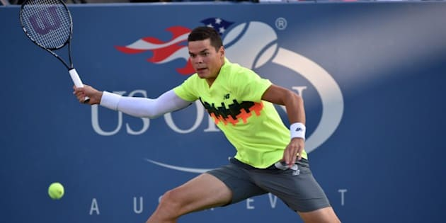 Milos Raonic of Canada returns a shot to Peter Gojowczyk of Germany during their 2014 US Open men's singles match at the USTA Billie Jean King National Tennis Center August 28, 2014 in New York. AFP PHOTO/Stan HONDA        (Photo credit should read STAN HONDA/AFP/Getty Images)