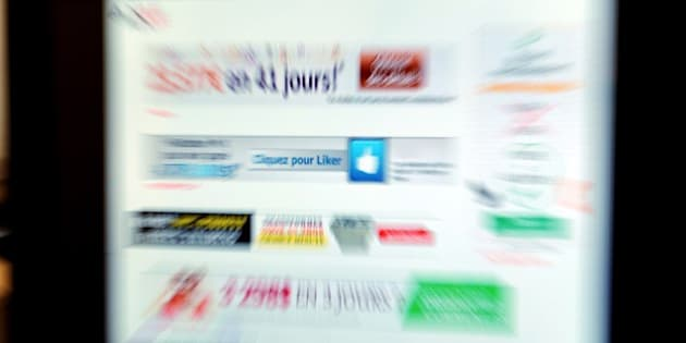 Picture taken at the AMF office in Paris on June 20, 2014 shows advertising Internet sites of Foreign exchange (Forex) type which are under watch by France's stock market regulator AMF due to their unbalanced sale propositions.  AFP PHOTO  ERIC PIERMONT        (Photo credit should read ERIC PIERMONT/AFP/Getty Images)