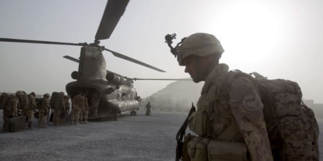 Cpl. Frederic Bouchard, 24, of Quebec, Canada, boards a helicopter at Forward Operating Base Sperwan Ghar with fellow soldiers of the Canadian Army's 1st Battalion Royal 22nd Regiment to begin their journey home Thursday, June 30, 2011 in the Panjwaii district of Kandahar province, Afghanistan. Canadian combat operations will end in July as troops withdraw from the southern region and hand control over to the Americans. Canada will transition to a non-combat training role with up to 950 soldiers and support staff to train Afghan soldiers and cops in areas of the north, west and Kabul. (AP Photo/David Goldman)