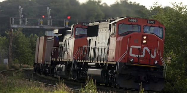 CN FREIGHT - 08/10/04 - A CN Rail container train heads east through Markham on the CN main line across the north of Toronto. for files. (Photo by Tony Bock/Toronto Star via Getty Images)