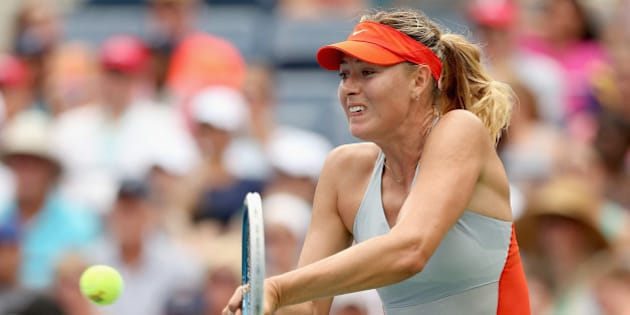 NEW YORK, NY - AUGUST 31:  Maria Sharapova of Russia returns a shot against Caroline Wozniacki of Denmark during their women's singles fourth round match on Day Seven of the 2014 US Open at the USTA Billie Jean King National Tennis Center on August 31, 2014 in the Flushing neighborhood of the Queens borough of New York City.  (Photo by Matthew Stockman/Getty Images)