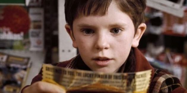 "FREDDIE HIGHMORE as Charlie Bucket in Warner Bros. Pictures' fantasy adventure ""Charlie and the Chocolate Factory,"" starring Johnny Depp.