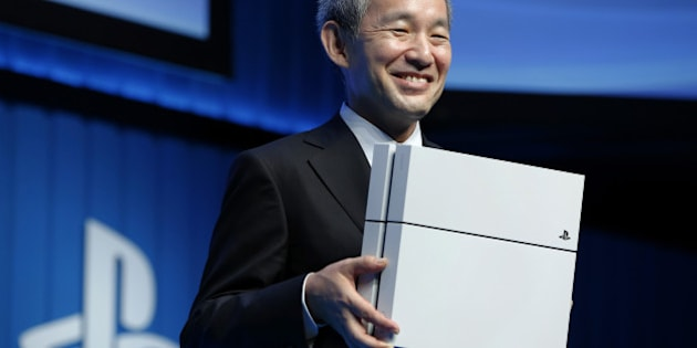 Atsushi Morita, president of Sony Computer Entertainment Japan Asia, holds a PlayStation 4 (PS4) games console as he poses for photographs during a news conference in Tokyo, Japan, on Monday, Sept. 1, 2014. Sony Corp. plans to offer 44 new games and updates for PlayStation Vita and PlayStation 4 in Japan, including Square Enix Holdings Co.'s Dragon Quest video-game series, according to Morita. Photographer: Kiyoshi Ota/Bloomberg via Getty Images