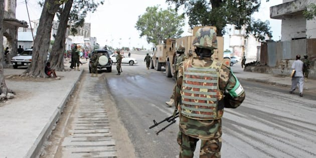 Soldiers of the African Union Mission in Somalia (Amisom) secure an area near the Godka Jillicow prison in Mogadishu on August 31, 2014. Somali security forces said on August 31 they had killed at least four Shebab militants, ending a coordinated car bomb and gun attack against the national intelligence headquarters and a detention facility in the capital Mogadishu. AFP PHOTO / ABDIFITAH HASHI NOR        (Photo credit should read ABDIFITAH HASHI NOR/AFP/Getty Images)