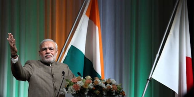Narendra Modi, India's prime minister, gestures as he speaks at a seminar hosted by Nikkei Inc. and Japan External Trade Organization (JETRO) in Tokyo, Japan, on Tuesday, Sept. 2, 2014. Prime Minister Narendra Modi and his Japanese counterpart Shinzo Abe at a summit meeting in Tokyo yesterday agreed to elevate ties to a special strategic and global partnership. Photographer: Tomohiro Ohsumi/Bloomberg via Getty Images