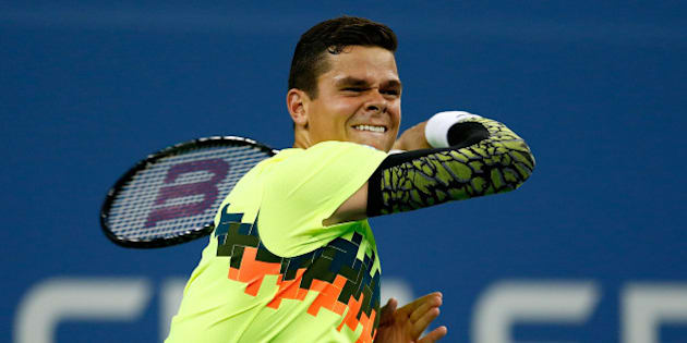 NEW YORK, NY - SEPTEMBER 01:  Milos Raonic of Canada in action against Kei Nishikori of Japan on Day Eight of the 2014 US Open at the USTA Billie Jean King National Tennis Center on September 1, 2014 in the Flushing neighborhood of the Queens borough of New York City.  (Photo by Julian Finney/Getty Images)